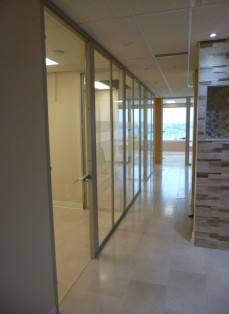 Office corridor with glass wall system