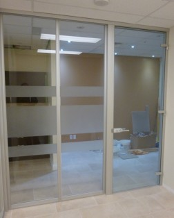 Floor to ceiling glass wall system