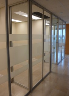 Glass wall system with frosted strips